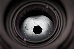 De openingsbladen van de lens stock foto's