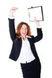 De opgewekte bedrijfsvrouw geniet van een succesvolle overeenkomst stock foto's