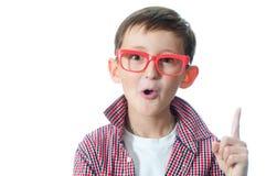 De opgewekte jonge jongen heeft een idee. Royalty-vrije Stock Afbeelding