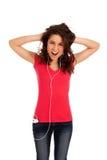 De opgewekte tiener luistert muziek stock fotografie