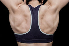 De opleiding van de vrouw in een gymnastiek Stock Foto