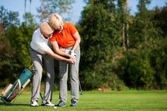 De opleiding van het golf in de zomer royalty-vrije stock afbeeldingen