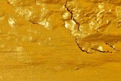 De oppervlakte barst oude gouden textuurachtergrond royalty-vrije stock afbeelding