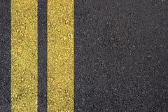 De oppervlakte van het asfalt met gele lijn Royalty-vrije Stock Afbeelding
