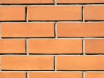 De oranje Achtergrond van de Bakstenen muur Stock Afbeelding