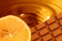 De oranje achtergrond van de chocolade royalty-vrije stock fotografie