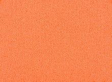 De oranje achtergrond van de sponstextuur, sluit omhoog mening van een kosmetische spons of het stootkussen voor gezichts maakt o stock afbeelding