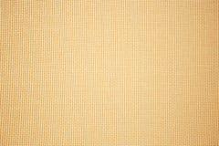 De oranje achtergrond van de stoffentextuur Natuurlijke stoffentextuur ondiepe DOF royalty-vrije stock afbeeldingen