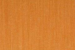 De oranje decoratieve de textuurachtergrond van de canvasstof, sluit omhoog Stock Afbeelding