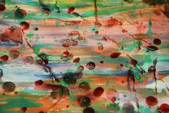 De oranje groene wasachtige achtergrond van de verfwaterverf Stock Foto's