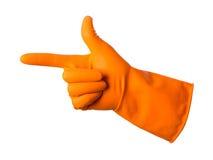 De oranje handschoenen voor het schoonmaken op het wapen van mensen tonen de wijsvinger Royalty-vrije Stock Fotografie