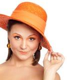 In de oranje hoed Royalty-vrije Stock Afbeeldingen