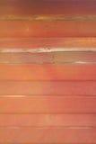 De oranje houten achtergrond van de muurtextuur Stock Foto's