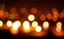De oranje lichten van Blured op zwarte achtergrond Royalty-vrije Stock Foto