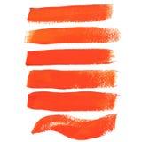 De oranje slagen van de inktborstel Royalty-vrije Stock Foto's