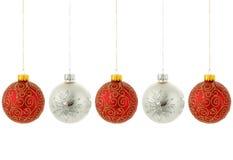 De ornamenten van de kerstboom het hangen Stock Foto's