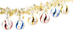 De ornamenten van Kerstmis in de vorm van gebieden en een klatergoud Stock Afbeeldingen