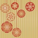 De Ornamenten van Kerstmis op een Gouden Achtergrond Stock Afbeelding