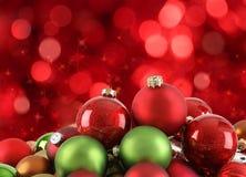 De ornamenten van Kerstmis van de kleur met abstract licht   Stock Foto
