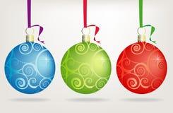 De Ornamenten van Kerstmis van Swirly van het trio royalty-vrije illustratie