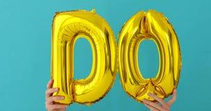 De oro HAGA la palabra hecha de globos inflables almacen de metraje de vídeo
