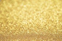 De oro Twinkly fotos de archivo
