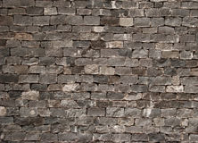 De oude achtergrond van de grunge donkere bakstenen muur de beeldachtergrond, perfectioneert voor uw presentaties Royalty-vrije Stock Afbeeldingen