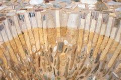De oude achtergrond van de de muurtextuur van de kasteelsteen Van de Brikssteen en muur textuur Griekse oude muur van kasteel stock afbeelding