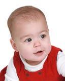 De oude baby van negen maanden in rode kleding royalty-vrije stock fotografie