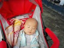 De oude baby van vier maanden Stock Foto