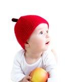 De oude baby van zeven maanden met appelen Stock Afbeeldingen