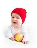De oude baby van zeven maanden met appelen Royalty-vrije Stock Foto's