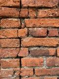 De oude bakstenen muurachtergrond stock afbeeldingen