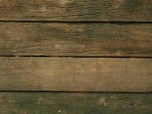 De oude donkere bruine houten achtergrond van de plankentextuur Royalty-vrije Stock Afbeeldingen