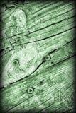 De oude Doorstane Gebarsten Geknoopte Textuur van Kelly Green Pine Wood Floorboards Vignetted Grunge stock foto