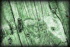 De oude Doorstane Gebarsten Geknoopte Textuur van Kelly Green Pine Wood Floorboards Vignetted Grunge stock fotografie