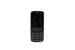 De oude gebroken mobiele telefoon isoleerde witte achtergrond Stock Foto