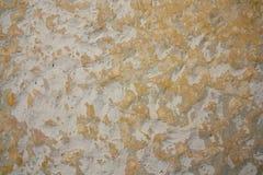 De oude gele textuur van de muurverf Stock Foto's