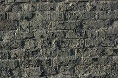 De oude grijze achtergrond van de bakstenen muurtextuur Stock Foto