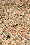De oude grond van de baksteenvloer Stock Foto's