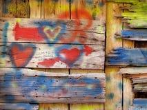 De oude houten graffiti van de muurliefde Stock Foto