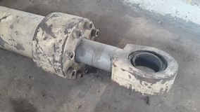 De oude hydraulische cilinder neemt machine royalty-vrije stock foto