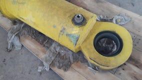 De oude hydraulische cilinder neemt machine royalty-vrije stock fotografie