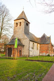 De oude kerkbouw op de gebieden België van Vlaanderen stock fotografie