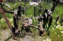De oude maaimachine van het Gevalhooi Stock Foto's