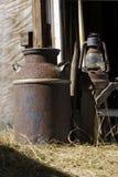 De oude melk kan Stock Foto's