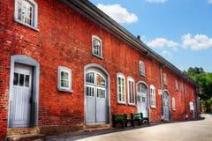 De oude rode baksteenbouw Stock Fotografie