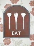 De oude rode houten achtergrond en het wit eten woord Stock Afbeelding