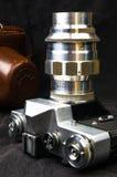 De oude sovjetcamera Zenit van filmslr - B met lens Jupiter-11 Stock Afbeeldingen