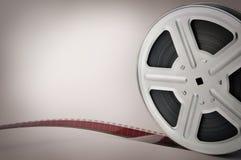 De oude spoel van de filmfilm op bruine achtergrond Royalty-vrije Stock Afbeelding